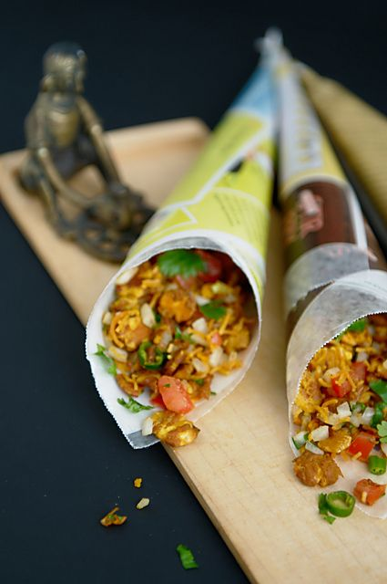 A popular Indian street snack, chana jor garam is made from flattened chickpeas, tossed with onions, tomatoes, green chiles and spices.