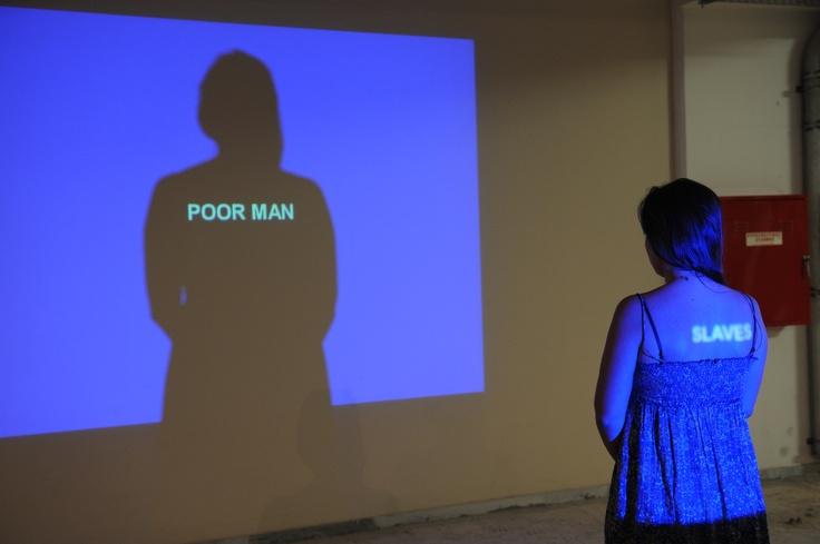 "Natascha Sadr Haghighian Empire of the Senseless Part II, 2006 two-channel video projection, 1'40'' loop dimensions variable © 2009 Natascha Sadr Haghighian Courtesy: Johann König, Berlin Installation view, 2nd Athens Biennale 2009 ""Heaven"""