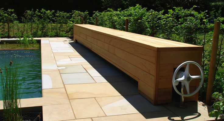 16 - Solar cover bench | The cedar-clad bench at one end of … | Flickr