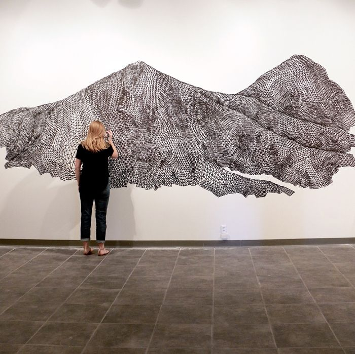 Markers Make Mountains in the Work of This Midwestern Artist. Katy Ann Gilmore draws faceted, monumental mountains on walls with markers. A Midwesterner transplanted to Los Angeles, Gilmore operates in meticulous expanses: her works run the gamut from pen and ink on paper to thread sculptures and even a piece of a hardware cloth fabricated in the shape of a tree limb.