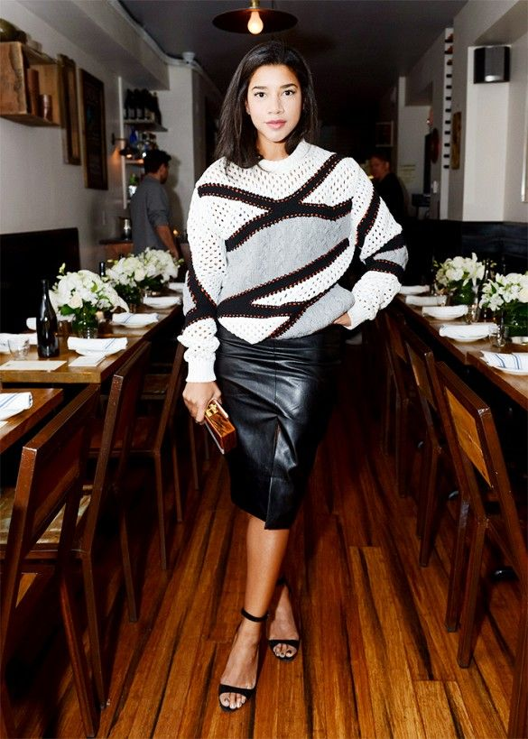 Hannah Bronfman wears a Public School blazer with a Topshop split front pencil skirt and an Edie Parker clutch.