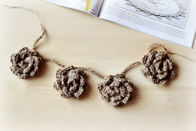 Love the modern, yet timeless look of these crocheted twine flowers. #flowers #crochet #craftts