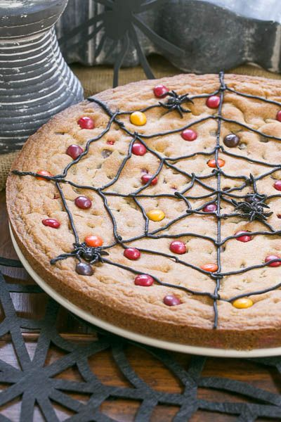 Spiderweb Cookie Cake | Perfect, easy Halloween treat! Or shake it up with other colors of M&M's and icing for any occasion!