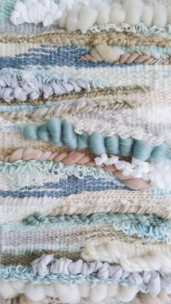 'Cordelia' named for the Celtic word meaning of the sea, is a delicate weaving that hangs beautifully on the wall. Handmade by Wallflower Weavings