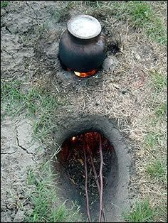 Cooking over a Dakota Fire Hole... saves wood and does not smoke... going to try this the next time we are out camping!!