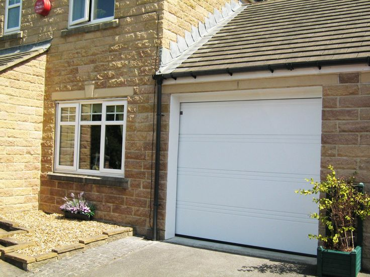 sectional garage doors throughout sectional garage doors Steel, Aluminum, and Wood Sectional Garage Doors