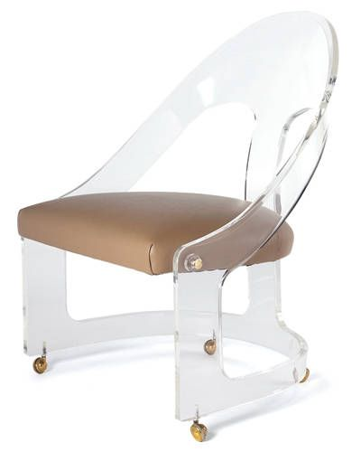 A 1960s chair- the perfect combo of lucite, brass, and leather.