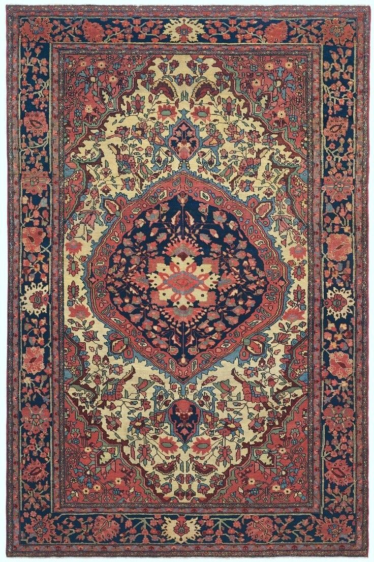 Exhibiting seemingly chiseled detail work and glowing richly dyed tones this superb antique ferahan sarouk rug attests to the impressive talent of an