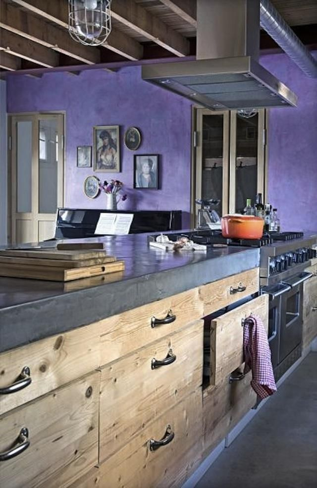 Colour matched with polished concrete worktop. Also DIY solid wood drawer fronts on a standard Ikea carcass.