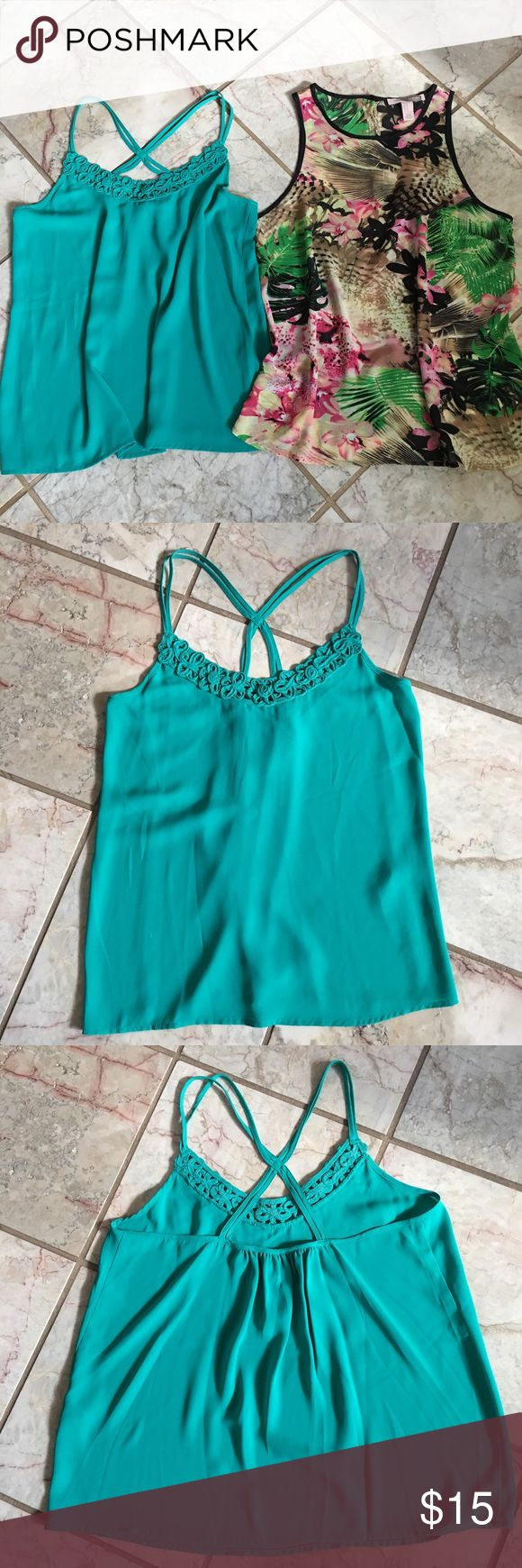 Forever 21 Tropical & Teal Tank Top Bundle Super cute Forever 21 tank top set, first is a Teal with double straps, has front detailing, color is a little darker then in person, second is the Hawaiian Tropical print, it's a little sheer, has kinda a leopard cheetah background print, pretty colors, also has a upper back cut out circle. Both are size medium. See all pictures Forever 21 Tops Tank Tops