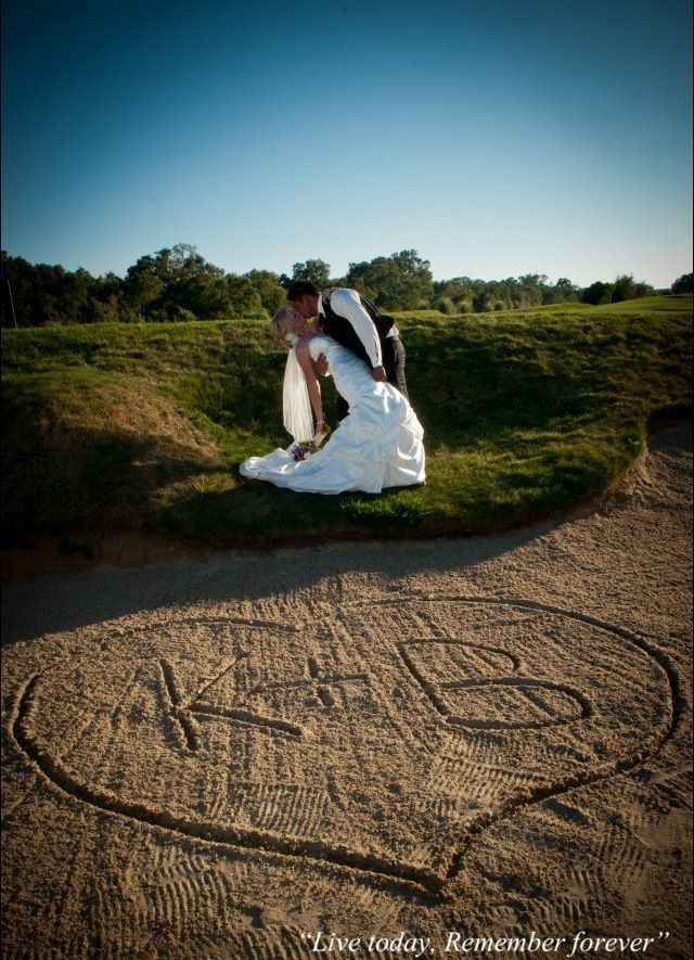 Writing initials in the sand for a golf course wedding