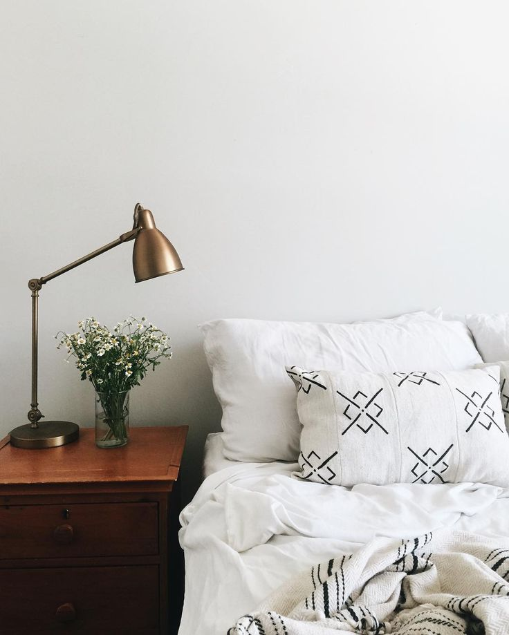 Simple bedroom with black and white patterned details.