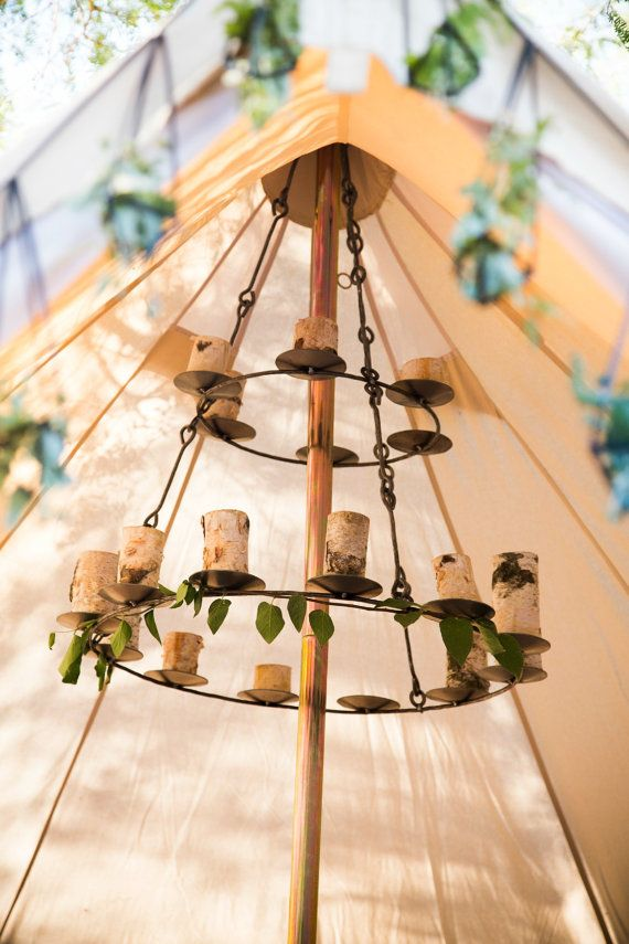 This chandelier can hold tea candles, or LED candles, or really anything you desire. Its made of the sturdiest iron and can be stored with your camping