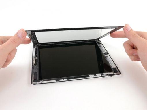Schritt 24 -       Nehmen Sie das iPad an den oberen und unteren rechten Ecken und drehen Sie die Frontscheibe aus dem iPad.      Etwas Kleber könnte immer noch dar sein, also verwenden Sie das Plektrum, um den verbleibenden Kleber von der Frontplatte zu trennen.