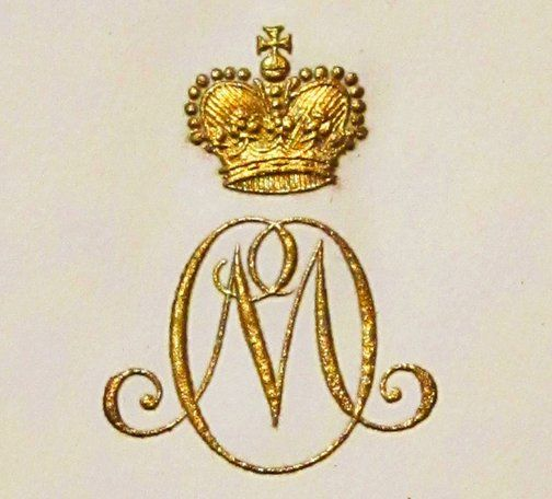 Hand made paper with a heavy gold monogram