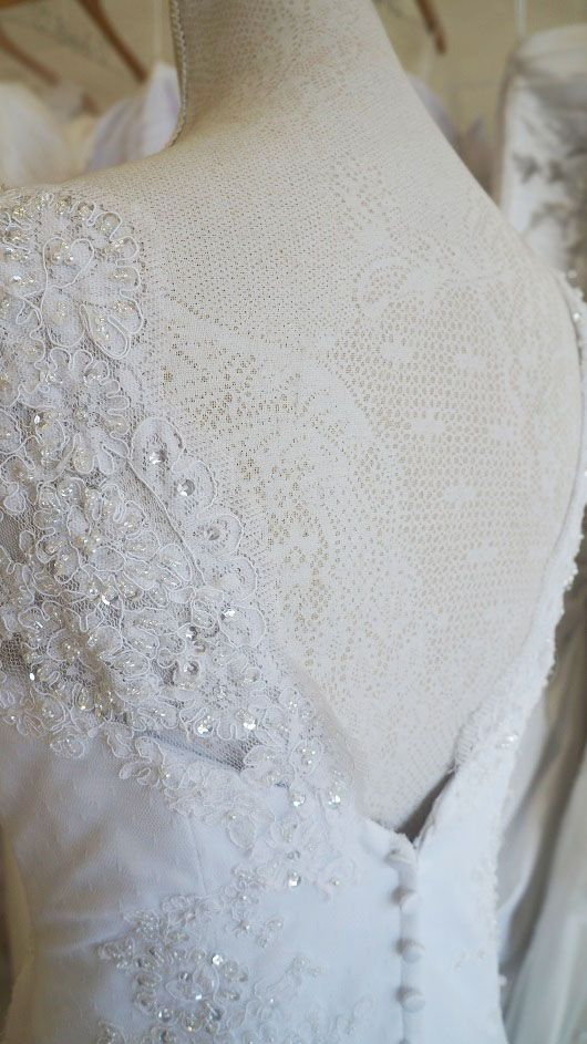 Lace trumpet wedding dress with pleated bodice. Urban Bride Cape Town.