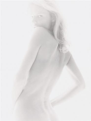 Delicate tonal range. Background light over-exposed to create blown-out lighting. Creates a very Summer-like feel.