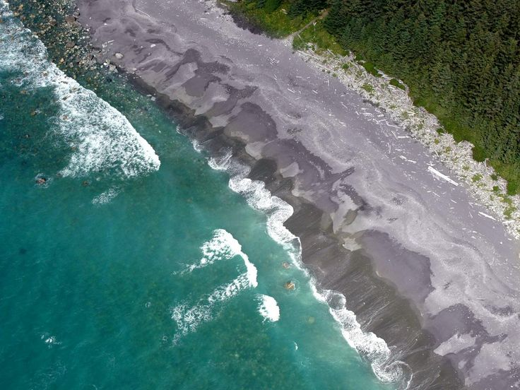 The Gulf of Alaska's shores have miles of gray sand near Yakutat, an isolated town with just 700 residents. The coast is also covered with driftwood that tends to wash up during violent winter storms. The area is part of Tongass National Forest and adjacent to Glacier Bay National Park and Preserve.