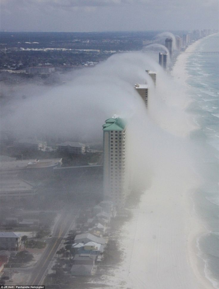Cloud Tsunami - Wave machine: Helicopter pilot Mike Schaeffer spotted this incredible weather phenomenon along the coast of Panama City Beach, Florida
