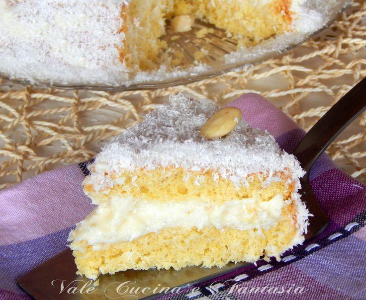 Torta Raffaello ricetta dolce soffice cremosa e golosa,il sapore è uguale a quello dei famosi cioccolatini fresca,esotica e dal gusto impeccabile