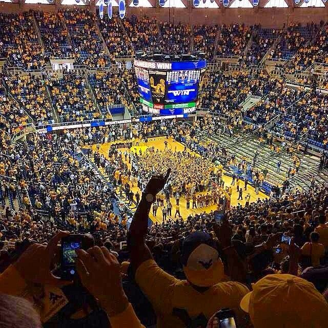Fans storm the court as #WVU men's basketball upsets No. 8 Kansas 92-86. (March 8, 2014)| Instagram photo by @brandon2414 (Brandon S Funk)