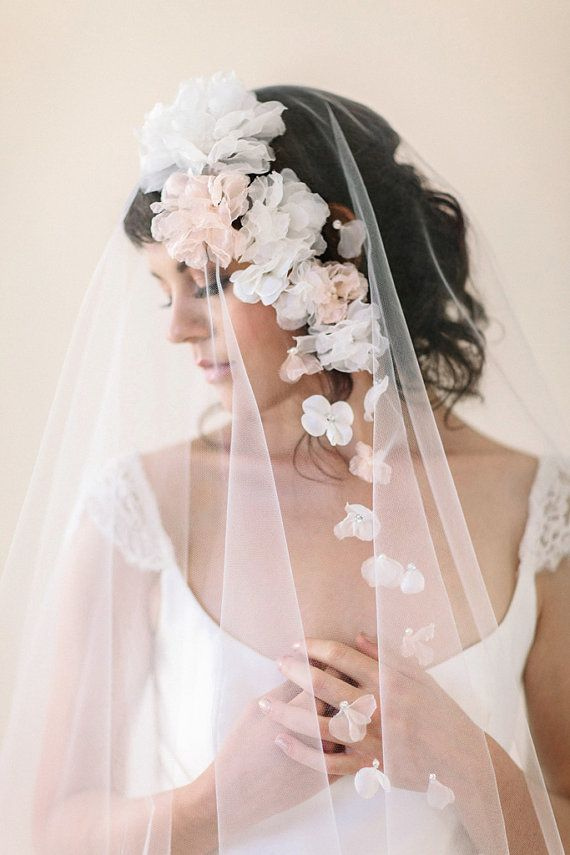 Dunno if I'll be a veil kinda bride, but I think all of the floral veils in this post are lovely. #floralveils #weddingveils