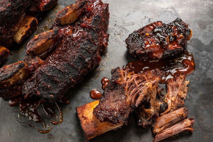An easy recipe for sweet and tangy beef short ribs cooked in the oven and then finished on the grill with homemade barbecue sauce.