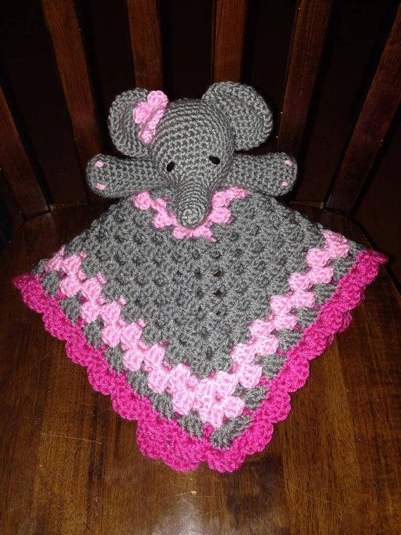 This adorable little elephant is looking for a home. The super soft lovey measures about 18 inches square. It is made with 100% acrylic yarn making it machine washable and dryable. There are no small parts making it perfect for baby. This is a perfect baby shower gift getting all