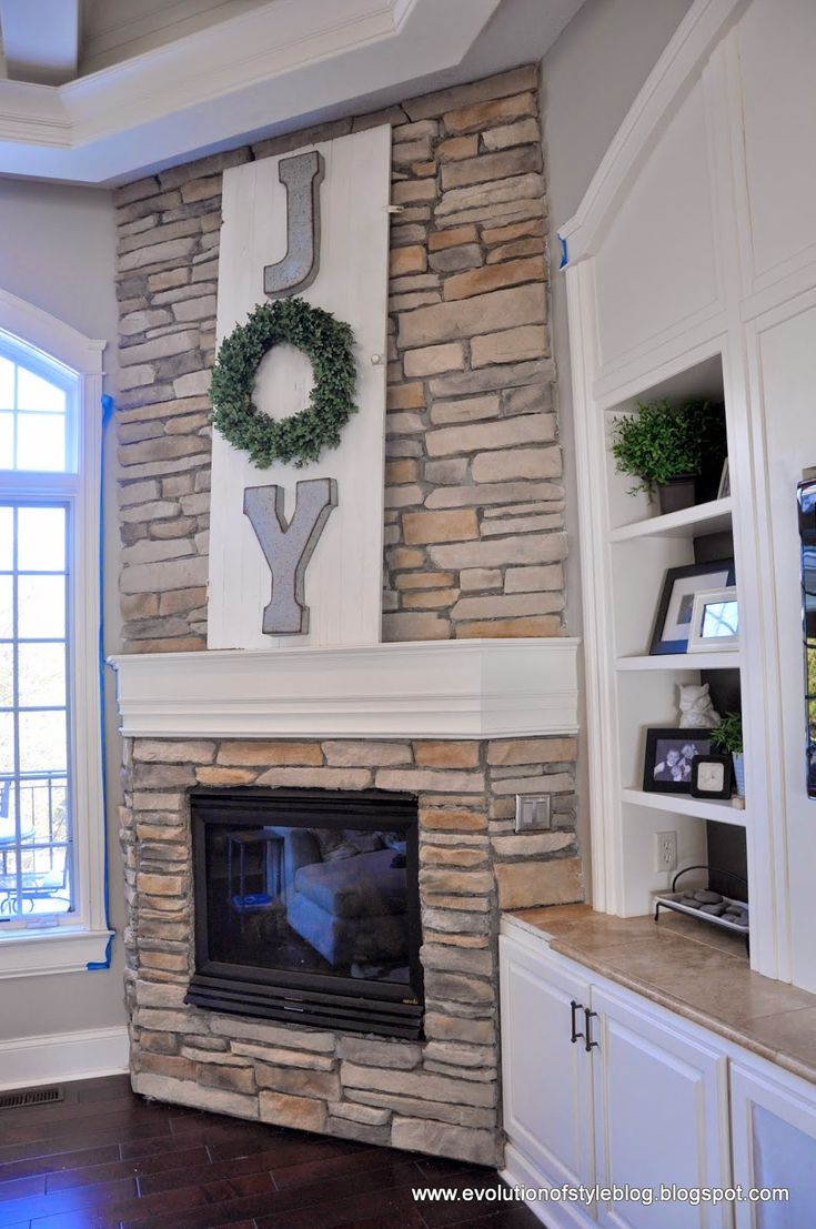 I would drill a hole and light the wreath up and hide cords behind the board...Evolution of Style: A High Impact/Low Budget Holiday Mantel: