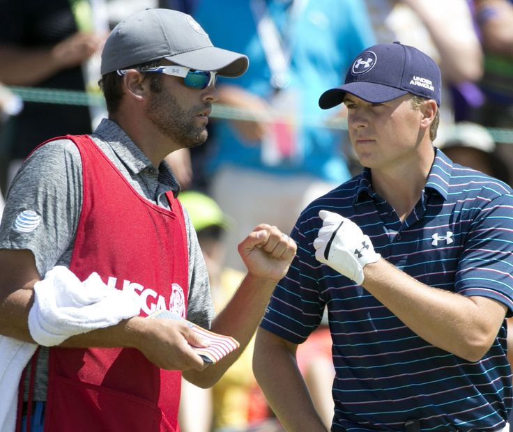 Jordan Spieth and his caddie Michael Greller talk before the final round of the U.S.