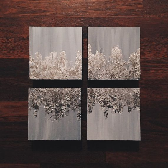 Arrange this classic set of four anyway you desire! These heavy duty canvas are streaked with different shades of light gray and splashed with silver! The sides are painted a dark gold. This piece has an elegant shine from every direction