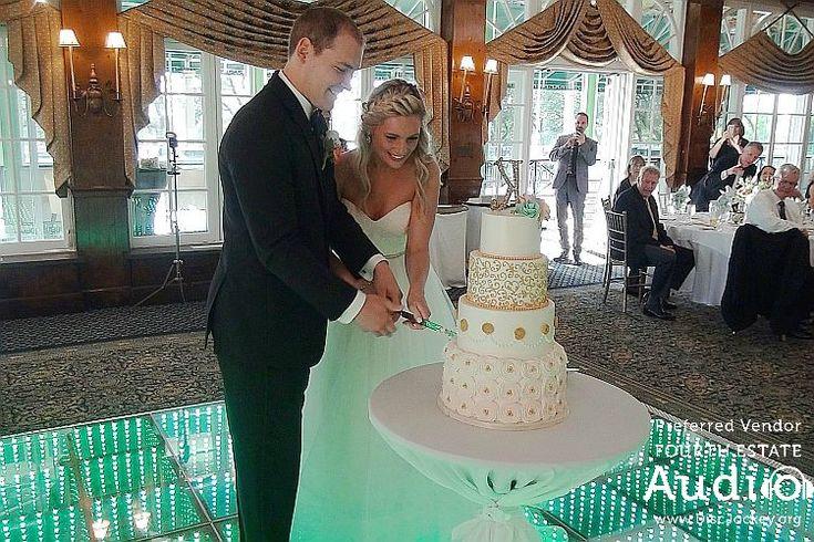 Brittany and Josh cut their wedding cake. http://www.discjockey.org/real-chicago-wedding-august-20-2016/