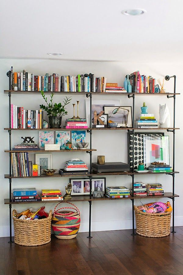 A shelving system like this would serve as a great desk/breakfast bar! I would just hide most of the clutter in cute storage bins, have a lot more plants, and make the desk (laptop) space wider (to suit 2)