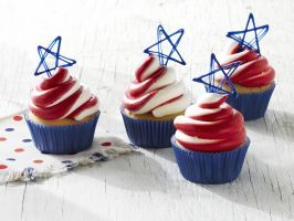 Stars and Stripes Cupcakes : Add a patriotic touch to your dessert spread by topping these fluffy vanilla cupcakes with a swirl of vanilla and raspberry frosting. For the blue star topper, microwave candy melts, then pipe the star shapes onto parchment paper and refrigerate until they've set.