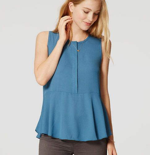 Paneled with a soft knit back, this flowy woven peplum is extra femme - and…