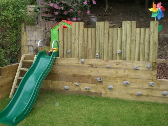 love this idea awesome play area fort with slide and rock wall rocks - Small Garden Ideas Kids