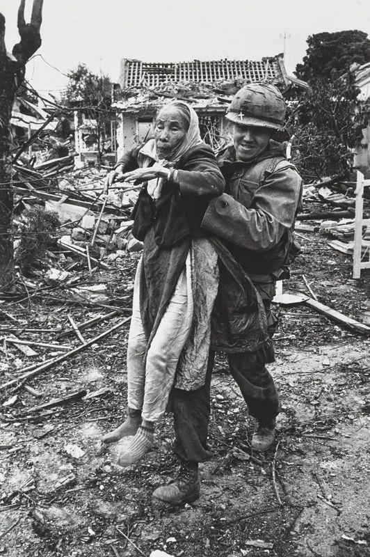 Don McCullin - A US Marine Chaplain helping an old Vietnamese woman</em>, 1968
