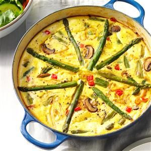 Asparagus-Mushroom Frittata Recipe -My Sicilian Aunt Paulina inspired this fluffy frittata. I remember visiting her garden, picking fresh veggies and watching her cook. Her wild asparagus frittata was my favorite. —Cindy Esposito, Bloomfield, New Jersey