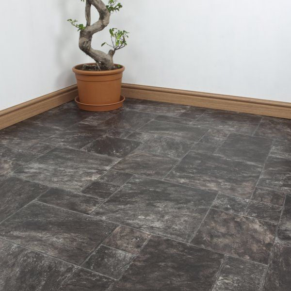 Another from the Serena range, this Charles cushioned vinyl floor has a marbled effect to it's tiles, with a realistic mismatched effect, giving you a gorgeous jigsaw puzzle of a floor. It's embossed for that extra layer of realism, with water resistance and durability, perfect for kitchens and bathrooms.