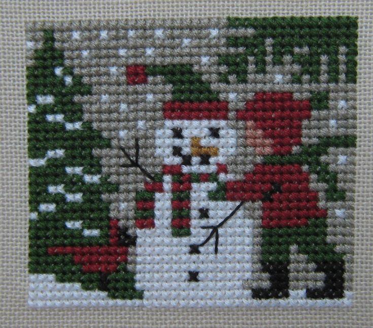 [IMG_0962.JPG]  boy building a snowman