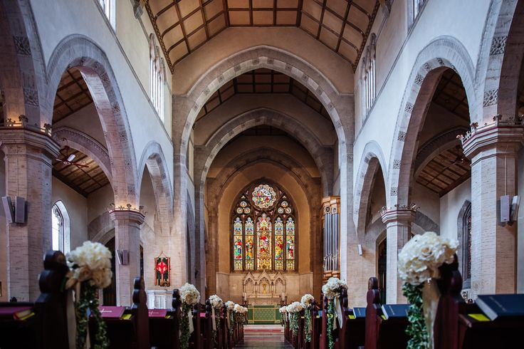 The stunning church decorated for the ceremony with little bunches of white flowers