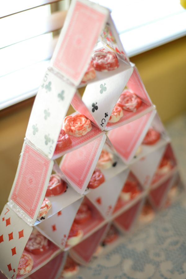 Red and white chocolate roses on a card house serving tower.  Brilliant for an Alice in Wonderland party!