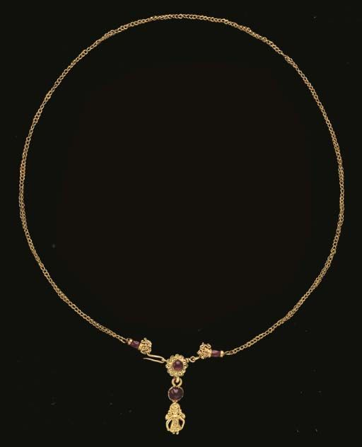 A GREEK GOLD AND GARNET NECKLACE. Hellenistic Period, c. 4th-2nd Century B.C.