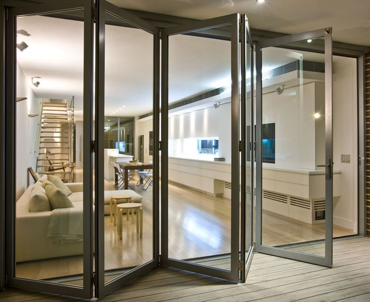 folding glass door would take up less space than the garage door but may