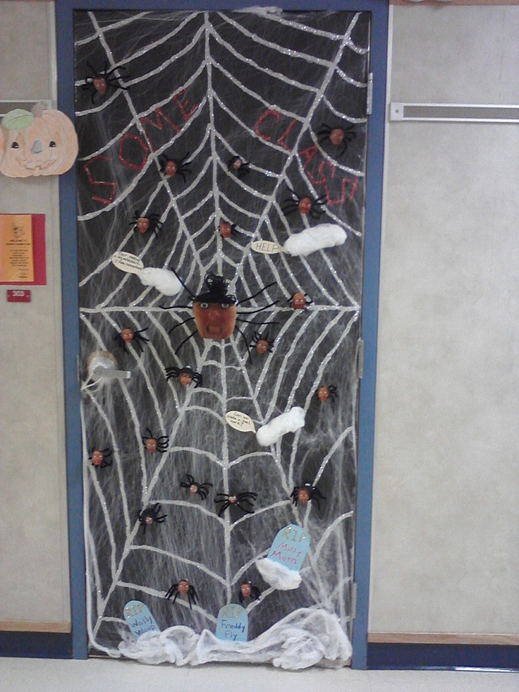 the spiders have pictures of the kids head glued on them and the the spiderspider webshalloween decorationshalloween