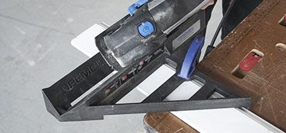 Step10 (continued): To complete a miter cut using your Saw-Max tool:   1. Measure and mark the desired cut line on the trim. 2. Position the Miter Guide over the wood in the designated     location of the cut. 3. Clamp the cutting guide to the workpiece in the desired     location to make the cut. 4. Firmly hold the tool and make the cut.