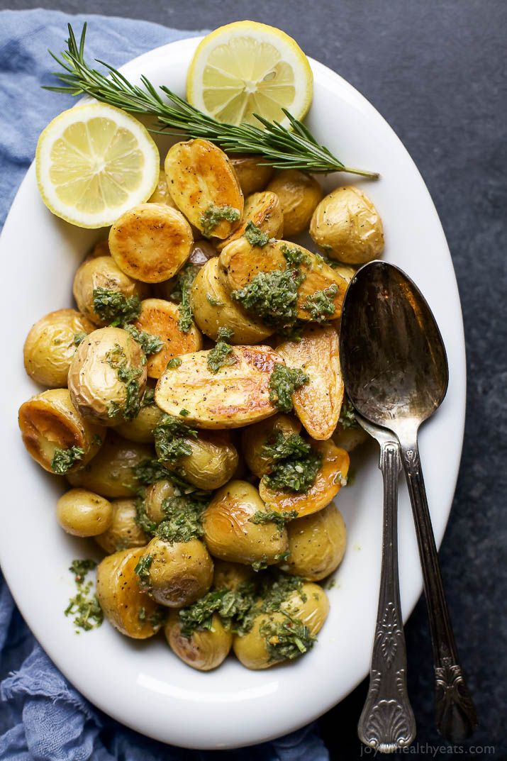 Crispy Roasted Potatoes drizzled with a fresh Sage Salsa Verde - the perfect change up on your holiday table. Sub the plain old mashed potatoes with these flavorful Roasted Potatoes! | joyfulhealthyeats.com #glutenfree