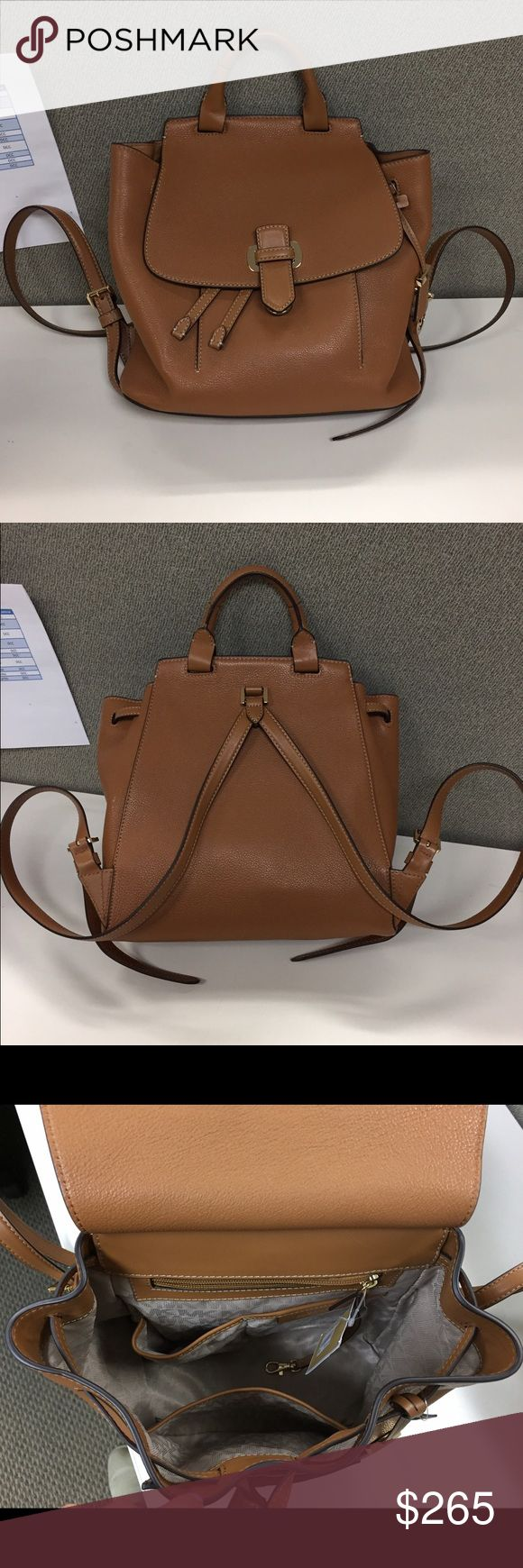 """Michael Kors Romy leather backpack- new with tag! The must have Romy Medium Backpack from MICHAEL Michael Kors comes elegantly crafted in luxe pebble leather with slender, adjustable straps. Bought a different backpack that I like more. 13"""" W x 11-1/2"""" H x 3-1/2"""" D Interior features 1 zip pocket, 2 utility pockets, 1 slip pocket and key clip 14-16""""L adjustable backpack straps Push-lock and drawstring closures Exterior features gleaming hardware and 1 front slip pocket Small pebble leather…"""