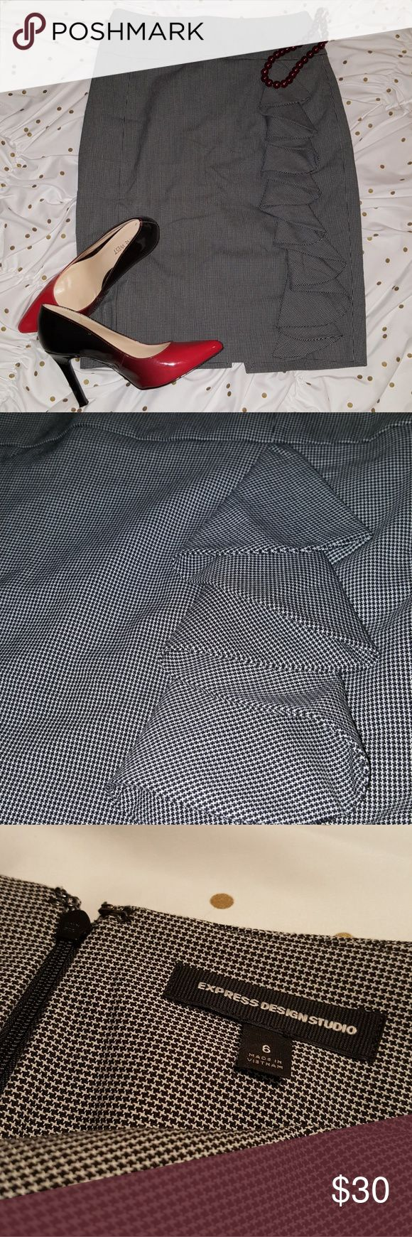 Houndstooth Pencil Skirt A sassy ruffle with classic houndstooth makes this high-waist pencil skirt the perfect mix of trendy and closet staple. Goes with everything and has a form fitting, flattering shape. Fits true to size. Worn once. Express Skirts
