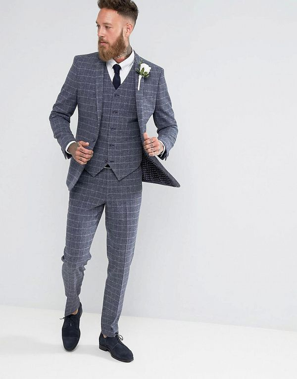 d17ece2c5e7 This chic 3 piece suit is made out of a textured wool-mix fabric with a  dapper grid check. It contains stretch for comfort and is lined with  internal ...